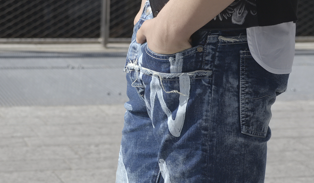 jeans detail of avant-garde man's outfit from Daad Dantone